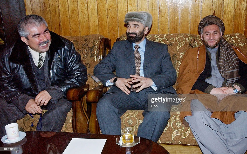 Factional leaders from northern Afghanistan, General Abdul Rashid Dostum (L) Atta Mohammed (C), and Ustad Sayeedi sit next to each other during a meeting at the Ministry of Foreign Affairs February 28, 2003 in Mazar-e-Sharif, Afghanistan. The group, which included numerous factional leaders from northern Afghanistan, and the United Nations High Commisioner for Refugees Ruud Lubbers, unanimously agreed to improve the infrastructure of the region so displaced people can return home.