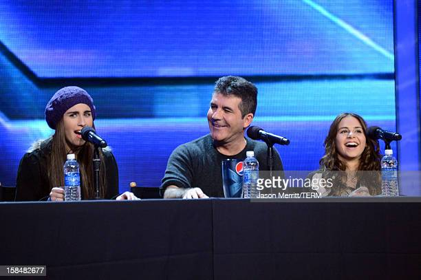 X Factor contestant Lauren Jauregui of Fifth Harmony producer Simon Cowell and X Factor contestant Carly Rose Sonenclar attend Fox's 'The X Factor'...