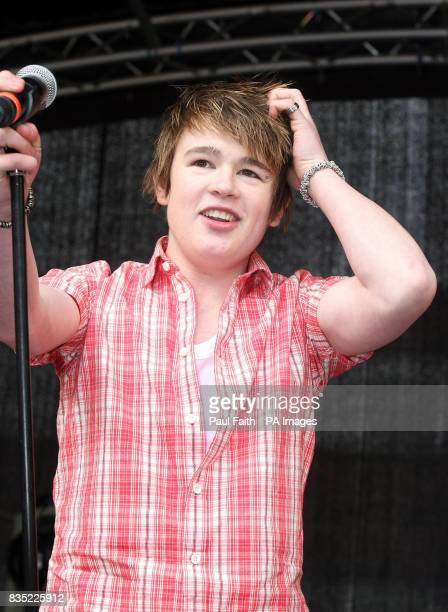 X Factor Finalist Eoghan Quigg performs during the St Patricks Day celebrations in Belfast where thousands of people were expected to join the...