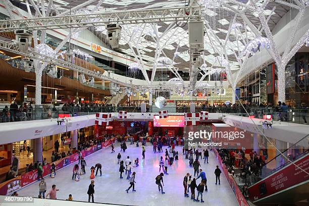 Factor finalist Lauren Platt makes a surprise performance at the Westfield London ice rink on December 23 2014 in London England