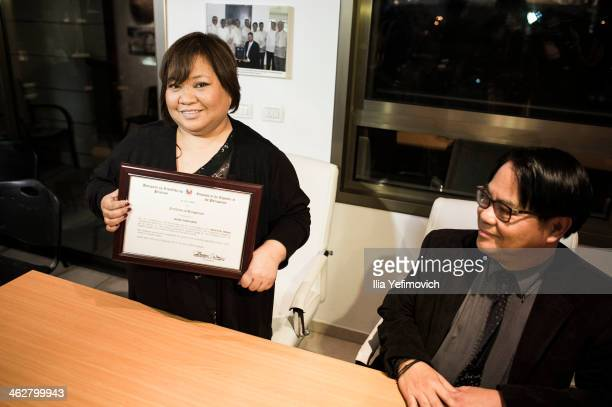 Factor Israel grand winner Rose Osang Fostanes received a certificate from Filipino Ambassador during a press conference with Philippine ambassador...
