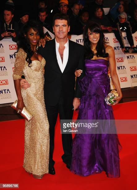 Factor judge Simon Cowell arrives with girlfriend Sinitta and guest at the National Television Awards held at O2 Arena on January 20 2010 in London...