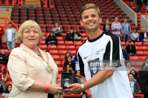 X Factors' Jeff Brazier collects his star player award during the Soccer Six football Tournament