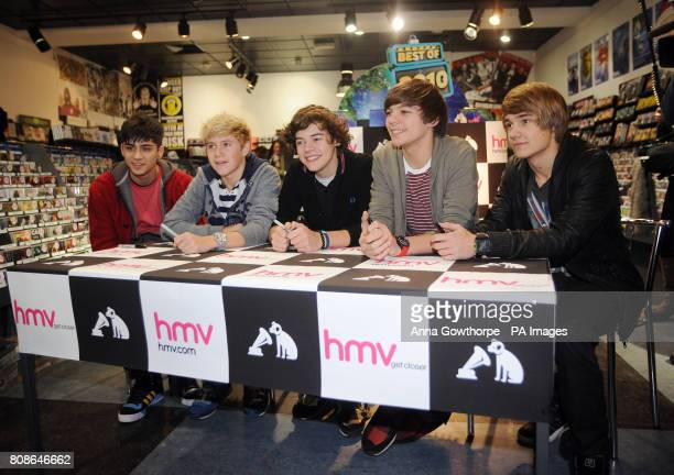 X Factor's One Direction left to right Zayn Malik Niall Horan Harry Styles Louis Tomlinson and Liam Payne at an autograph signing session at the HMV...