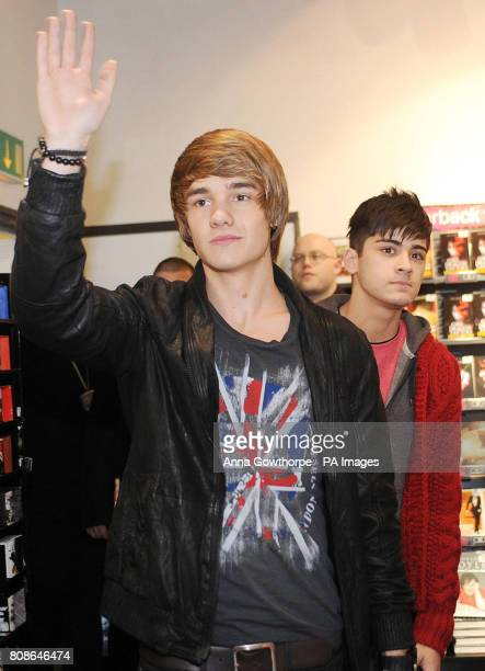 X Factor's One Direction members Liam Payne and Zayn Malik arrive for an autograph signing session at the HMV store Bradford