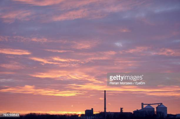 Factory Against Cloudy Sky During Sunset