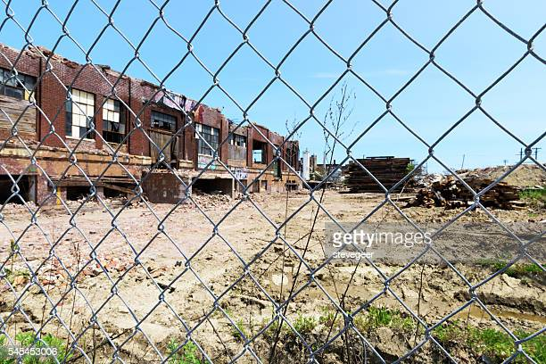 Factory demolition   through chainlink  fence