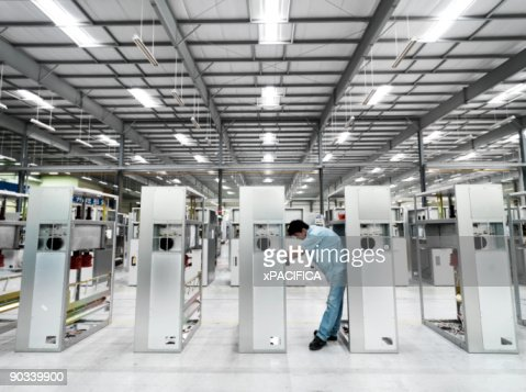 A factory employee doing product inspection. : Stock Photo