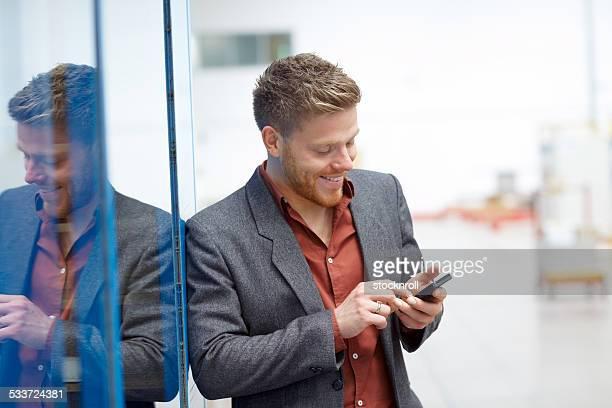 Factory employee using smart phone - Text messaging