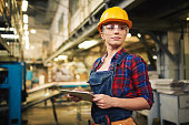 Young factory worker controlling the work