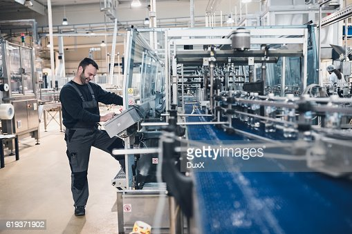 Factory indors. People at work. : Stock Photo