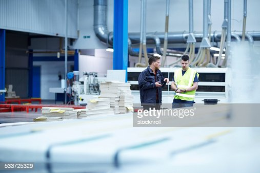 Factory shopfloor with workers discussing