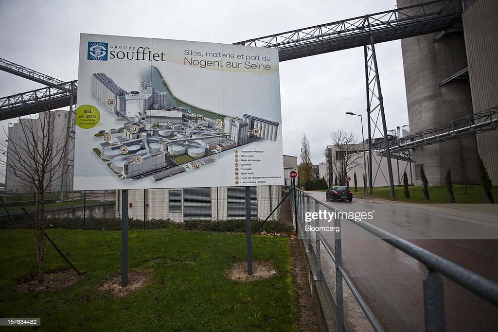 A factory site plan sits on a sign displayed at the entrance to the Groupe Soufflet plant in Nogent-sur-Seine, France, on Tuesday, Dec. 4, 2012. European Union corn imports may be the second-highest on record this season after drought parched crops and a surge in wheat exports curbed domestic grain supply. Photographer: Balint Porneczi/Bloomberg via Getty Images