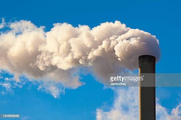 Factory Smokestack Billowing Dirty Pollutants Into Air, Blue Sky