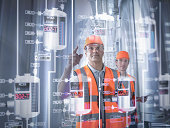 Factory supervisor monitoring product levels on interactive screen