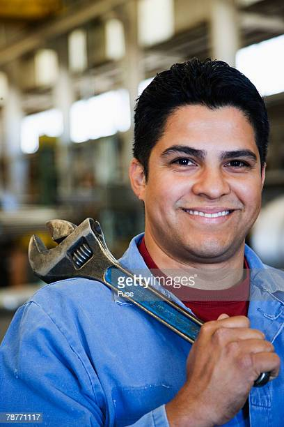 Factory Worker Holding Tongs