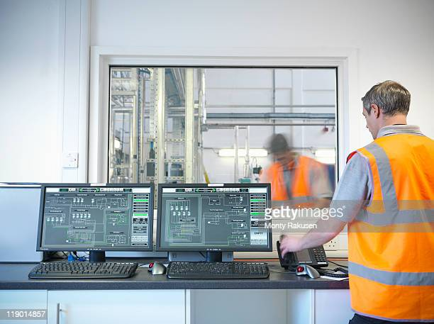 Factory worker in control room of plant