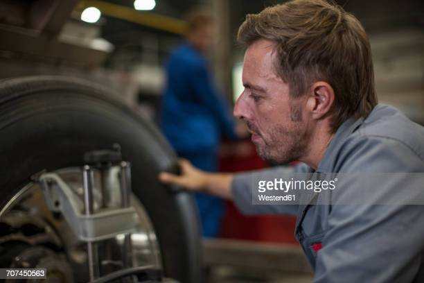 Factory worker in truck manufacture