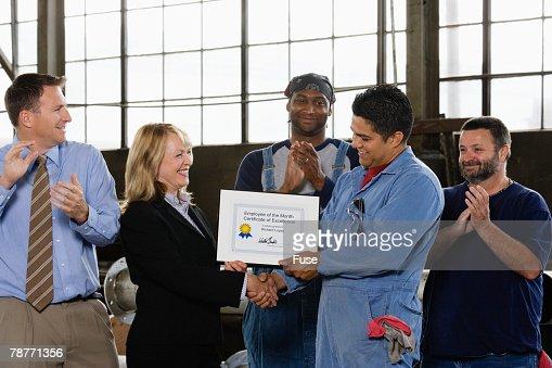 Factory Worker Receiving Certificate