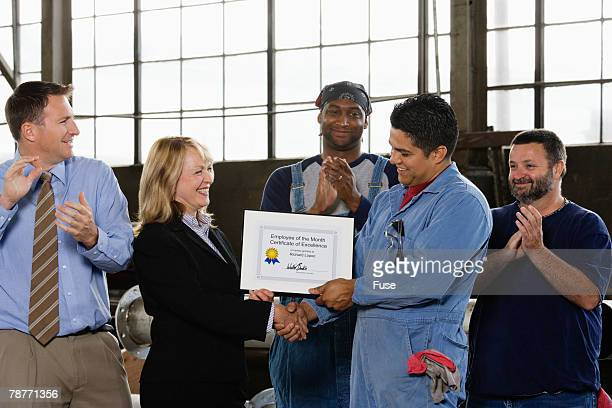 Factory Worker Receiving Certificate