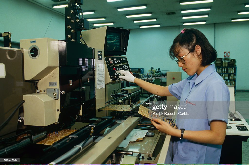 A factory worker tests electronics components at the Samsung factory in Seoul, where computers and televisions are manufactured.