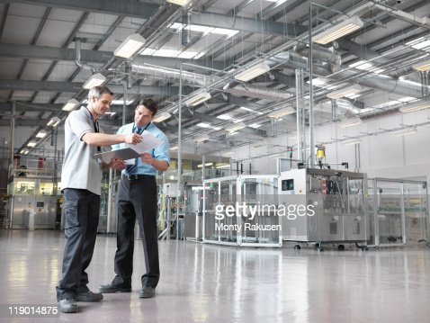 Factory workers in bottling plant