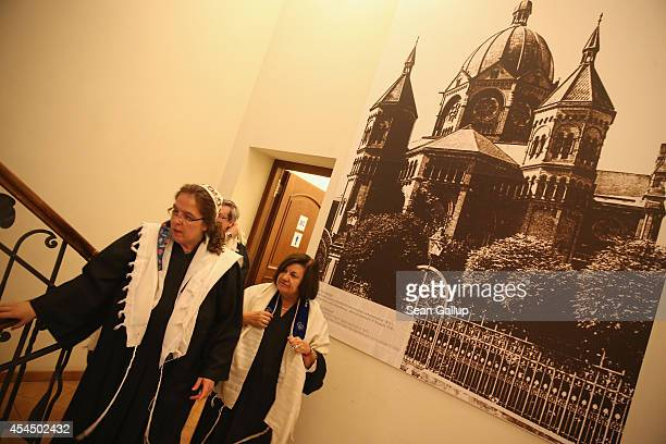 Faculty members of the Abraham Geiger College walk past a picture of the New Synagogue which was burned down by the Nazis in the Kristallnacht pogrom...