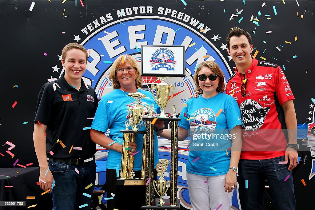 Faculty of E.P. Rayzor Elementary pose with Verizon IndyCar Series driver Graham Rahal and NASCAR Camping World Truck Series driver Christopher Bell after winning the overall school championship during the Speeding To Read Championship Assembly at Texas Motor Speedway on May 24, 2016 in Fort Worth, Texas.