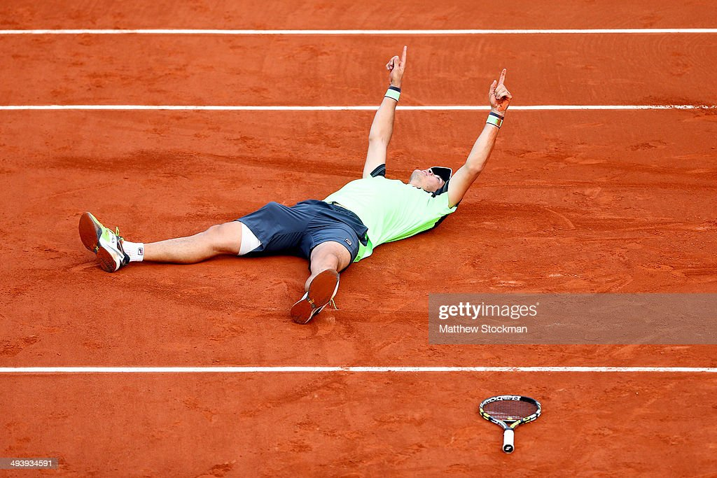 Facundo Bagnis of Argentina celebrates match point in his men's singles match against Julien Benneteau of France on day two of the French Open at Roland Garros on May 26, 2014 in Paris, France.