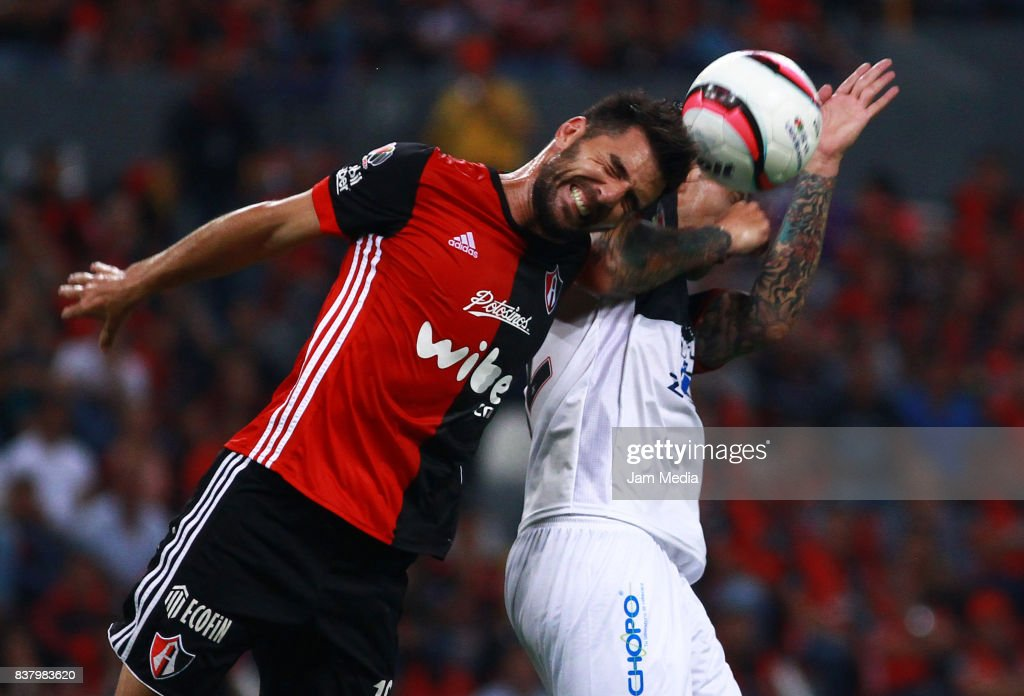 Facundo Erpen (L) of Atlas and Jonathan Fabbro (R) of Lobos BUAP jump for a header during the 6th round match between Atlas and Lobos BUAP as part of the Torneo Apertura 2017 Liga MX at Jalisco Stadium on August 22, 2017 in Guadalajara, Mexico.