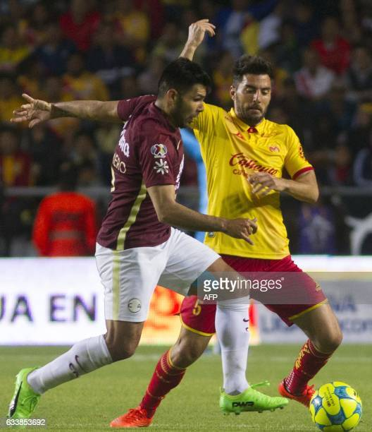 Facundo Erpen of Morelia vies for the ball with Silvio Romero of America during their Mexican Clausura 2017 Tournament football match at the Morelos...