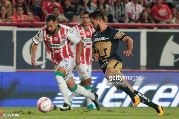 Facundo Pereyra of Necaxa fights for the ball with Luis Quintana of Pumas during the 13th round match between Necaxa and Pumas UNAM as part of the...