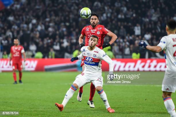 Facundo Piriz of Montpellier and Amine Gouiri of Lyon during the Ligue 1 match between Olympique Lyonnais and Montpellier Herault SC at Parc...