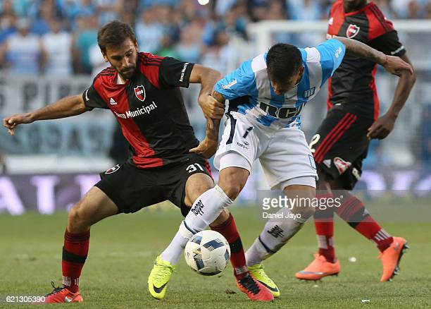 Facundo Quignon of Newell's Old Boys and Gustavo Bou of Racing Club fight for the ball during a match between Racing Club and Newell's Old Boys as...