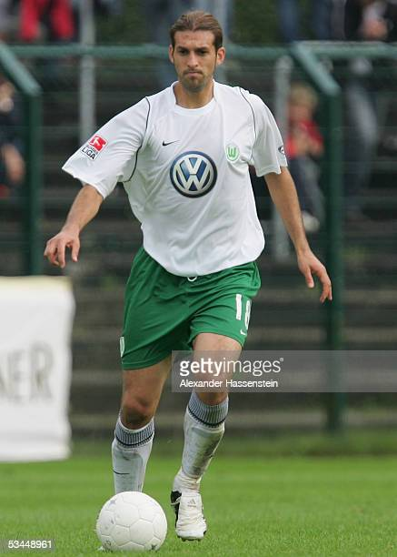 Facundo Quiroga of Wolfsburg runs with the ball during the DFB German Cup match between SC Paderborn and VFL Wolfsburg at the Hermann Loens Stadium...