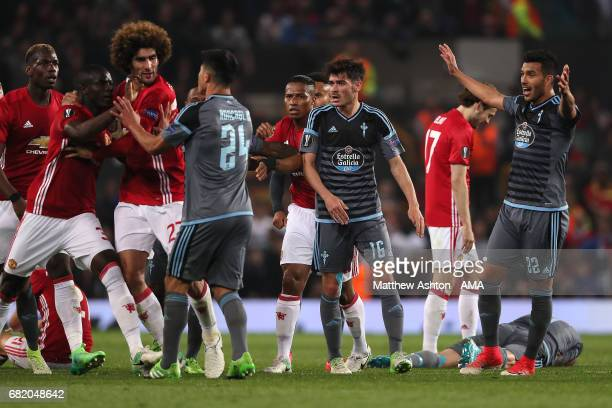 Facundo Roncaglia of Celta Vigo and Eric Bailly of Manchester United clash during the UEFA Europa League semi final second leg match between...