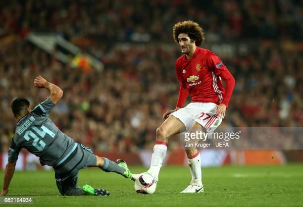 Facundo Roncaglia of Celta Vigo tackles Marouane Fellaini of Manchester United during the Uefa Europa League semi final second leg match between...