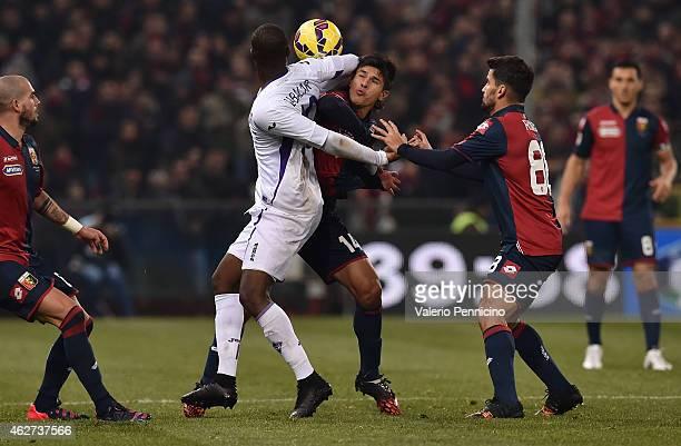 Facundo Roncaglia of Genoa CFC clashes with Khouma Babacar of ACF Fiorentina during the Serie A match between Genoa CFC and ACF Fiorentina at Stadio...