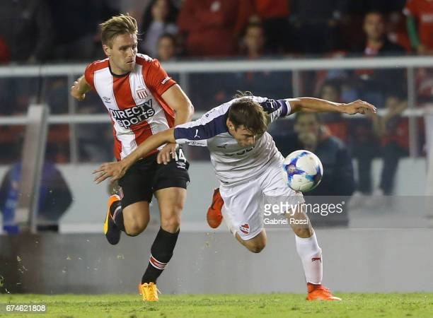Facundo Sanchez of Estudiantes fights for the ball with Nicolas Tagliafico of Independiente during a match between Independiente and Estudiantes as...
