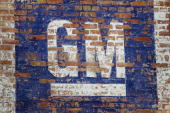 A faded General Motors Co logo is painted on a wall above a car dealership on April 7 2010 in Chicago Illinois A spokesperson for General Motors said...
