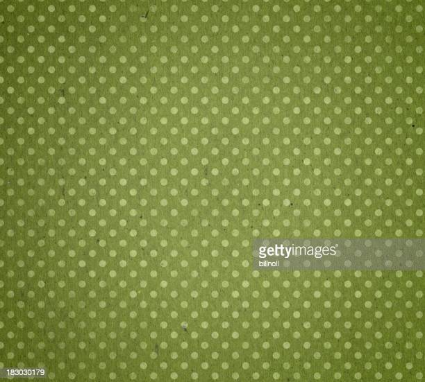 faded green paper with polka dots