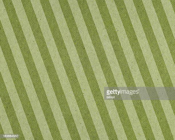 faded green striped paper with halftone