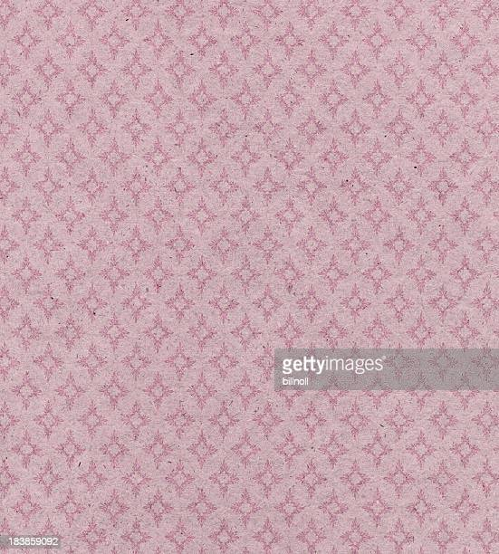faded pink paper with ornament