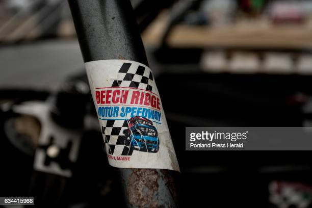 A faded sticker clings to the roll cage of a stock car before a race on Nascar Nite at Beech Ridge Motor Speedway in Scarborough Saturday July 25 2015