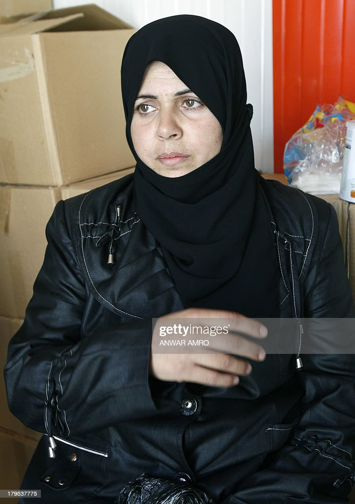 HASNI - Fadia, a Syrian refugee wife and mother of Syrian rebels, speaks sitting at a charity centre, shortly after she crossed the Lebanese border with Syria on September 4, 2013 in Masnaa. Fadia refused to leave her war-torn country until the very last minute despite the violence ravaging her home city, the capital Damascus but she finally made the decision to go, pushed by her son who feared for her safety if the United States decided to launch military strikes against the regime. The charity center belongs to a Lebanese charity financed by Qatari benefactors.