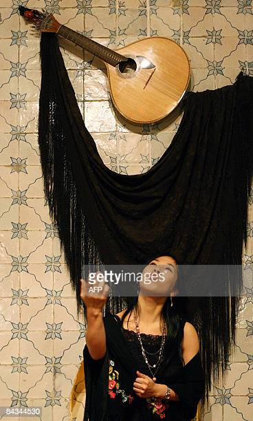 Fado singer Kumiko Tsumori of Japan performs by a Portuguese guitar in a restaurant in downtown Lisbon on January 17 2008 The 28 yearsold theatre...