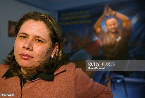 Fadwa Barghouti wife of Marwan Barghouti sits in front of a poster of her husband November 21 2004 in Ramallah West Bank Marwan Barghouti who is...