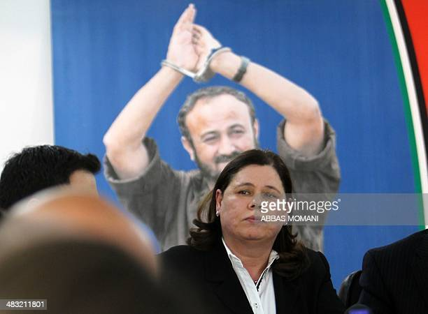 Fadwa Barghuti the wife of jailed Fatah leader Marwan Barghuti listens during a press conference to mark 12 years since her husband was arrested on...
