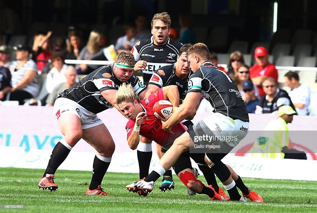 Faf de Klerk of the Pumas is tackled by Gerhard Engelbrecht of the Cell C Sharks during the Absa Currie Cup match between Cell C Sharks and Steval...