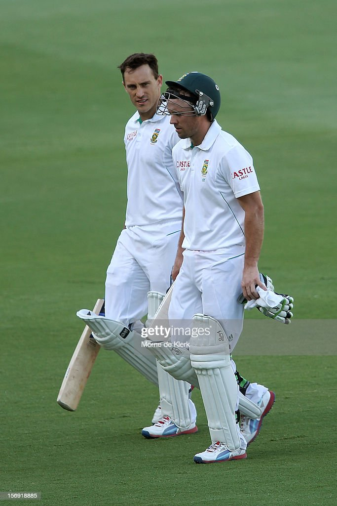Faf du Plessis and AB de Villiers of South Africa leave the field at the end of play on day four of the Second Test Match between Australia and South Africa at Adelaide Oval on November 25, 2012 in Adelaide, Australia.